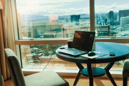 HVAC Challenges desk with laptop and view of Las Vegas